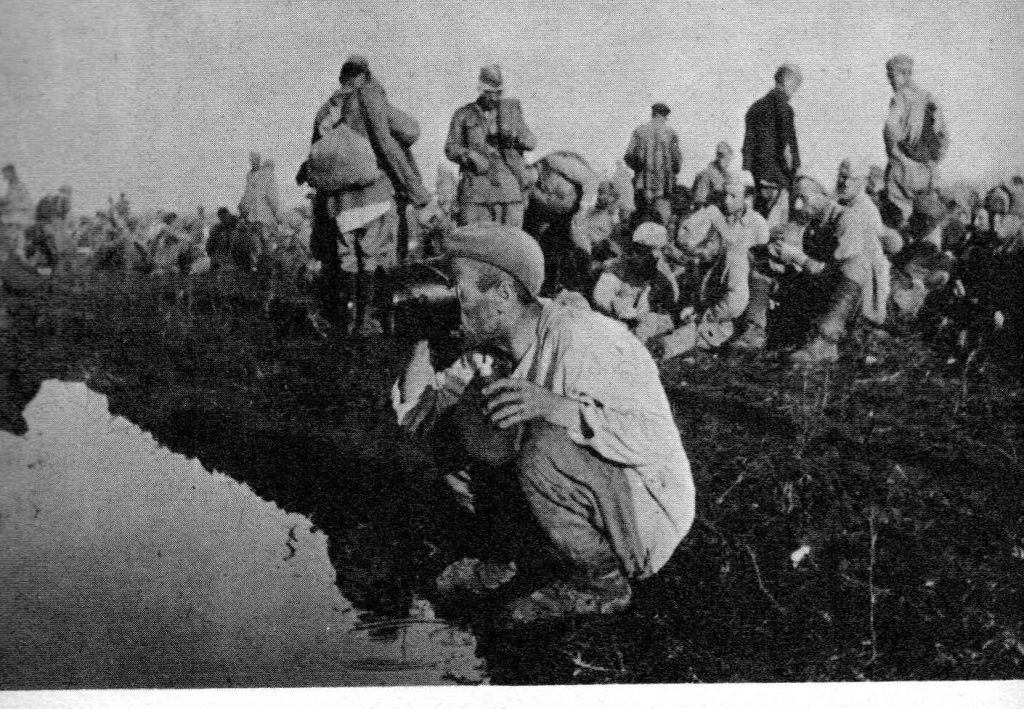 Russian World war 2 drinking from a stream
